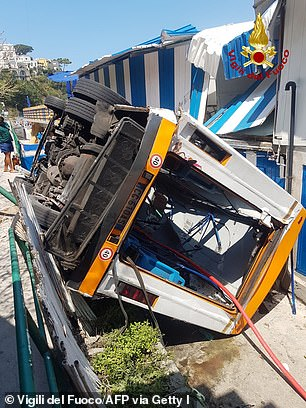 Pictured: The minibus after it crashed in Capri, Italy on July 22, 2021