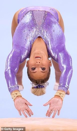 The purple one-piece was bedecked with3,468 Swarovski crystals