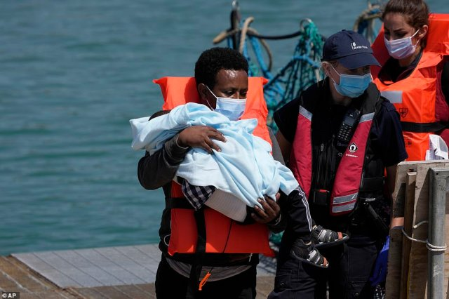 A baby was among those brought onto shore after the vessels were intercepted as they journeyed across the seas