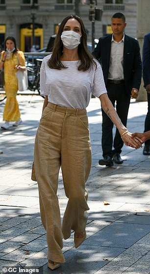 Chic: Angelina boosted her height with a pair of beige heels