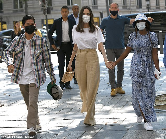 Doting: While out and about, Angelina was seen holding Zahara's hand as Pax and Shiloh walked beside them