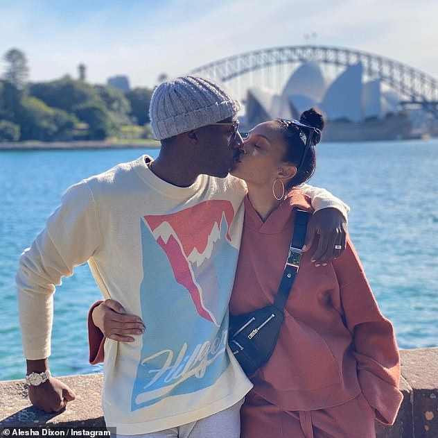 Pucker up: A second shot saw the pair fold for a sweet kiss as they posed in front of the iconic Sydney Harbor Bridge and Sydney Opera House