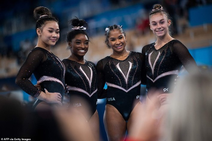 US gymnasts (from left) Sunisa Lee, Simone Biles, Jordan Chiles and Grace McCallum pose after a training session