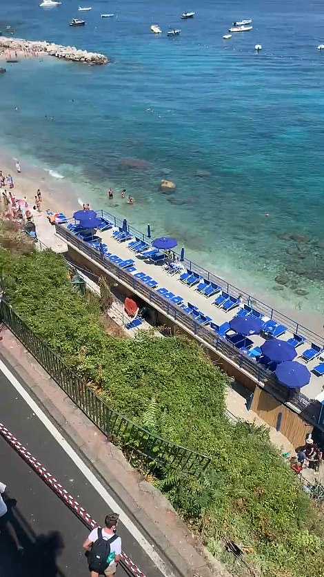 Pictured: A view of the beach resort below the road the mini bus crashed off