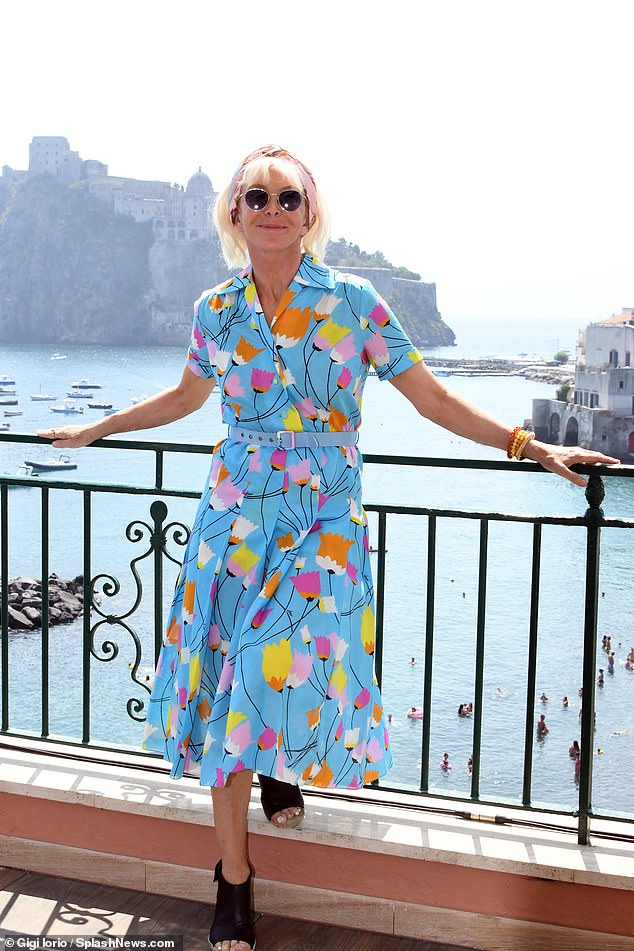Stunning: Trudie caught the eye in her summery frock, which boasted a pale blue belt around her toned waist and a pleated skirt
