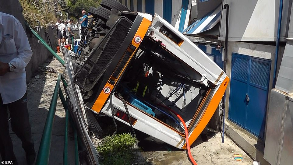 Pictured: A view of the scene of an accident, where a minibus carrying a dozen people veered off a road and crashed and fell around 20 feet, on Capri island, southern Italy, 22 July 2021