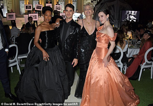Group Photo: Regina looked stunning in a black strapless Schiaparelli haute couture dress and Boucheron jewelry selected by styling duo Wayman + Micah