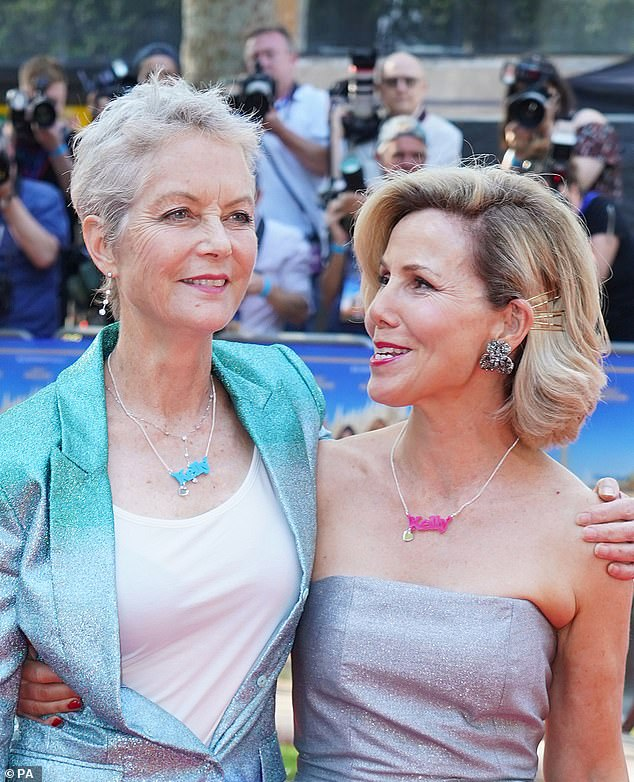 Sparkles: Sally paired her poignant piece of jewelry with a strapless sparkly silver dress and Jenny donned a striking silver and blue suit