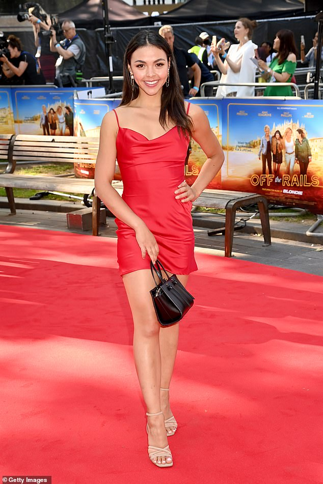 Leggy: She showed off her incredible gym-honed figure in the tight red dress as she walked the red carpet