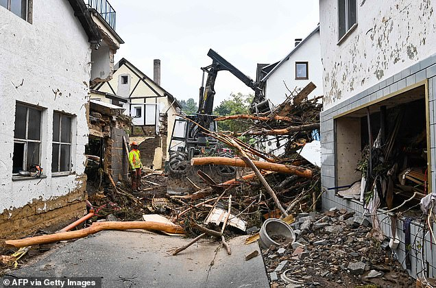Workers clear a destroyed street after the floods caused major damage in Schuld near Bad Neuenahr-Ahrweiler