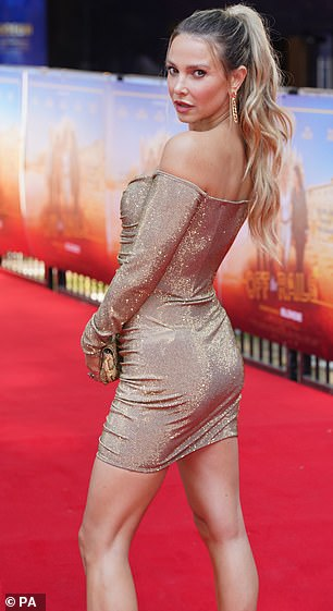 Sparkly number: The reality star glistened on the red carpet in the golden dress