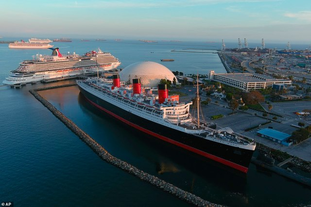 Officials in Long Beach, California are considering paying $190 million to dismantle and sink the Queen Mary - the historic cruise liner that has been docked on the city's shore since 1964. The vessel is pictured in the foreground of the above image, taken in April this year