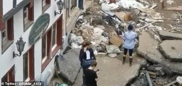 She muddied herself, apparently to pretend she had lent a hand with the clean up effort in Bad Munstereifel following heavy flooding that claimed at least 128 lives in Germany