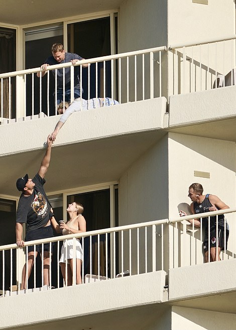 A man is pictured sharing marshmallows with a woman in the room above while isolating as a part of the NRL's family bubble.There's no suggestion the other people pictured have broken the bubble's rules