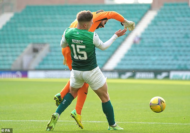 Hibs got a penalty when Miguel Angel Ramos against Kevin Nisbet.  clattered