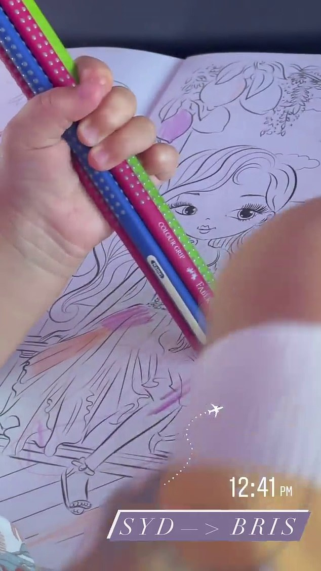 Mum on the move!She kept her daughter Tullulah entertained on the flight with colouring in pencils and an activity book