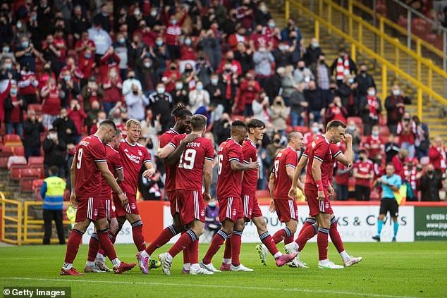 Stephen Glass hailed the return of Aberdeen's fans after their European victory at Pittodrie
