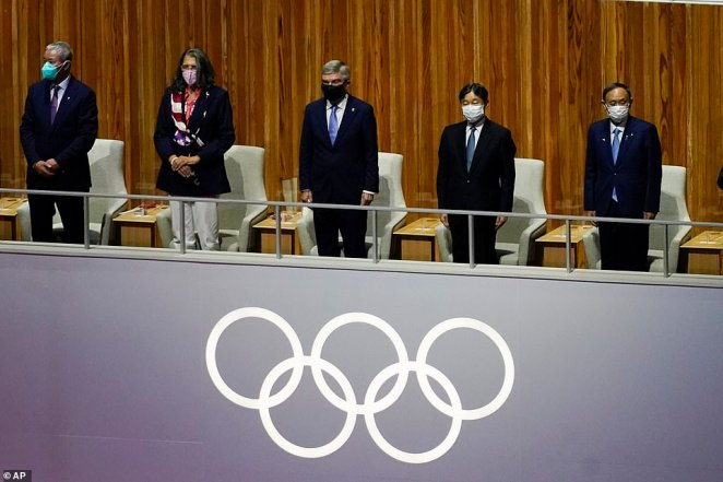 President of the International Olympic Committee Thomas Bach (centre), Japanese Emperor Naruhito (second right) and Japanese Prime MinisterYoshihide Suga (far right) enter the Olympic arena as during the opening ceremony