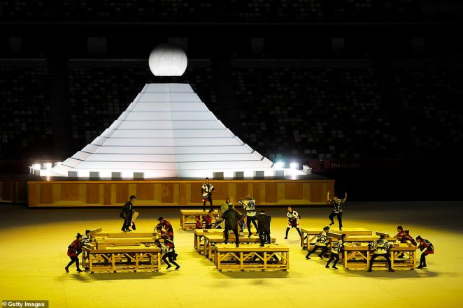 A group of performers carry out a routine during the Opening Ceremony of the Tokyo 2020 Olympic Games