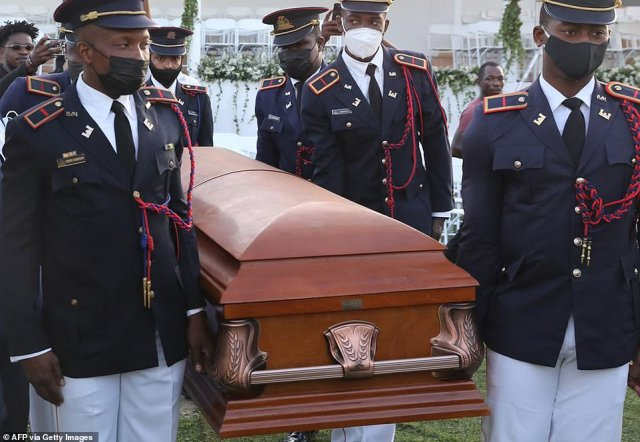 Pallbearers in military attire carried late Haitian President Jovenel Moise's body in a closed wooden coffin