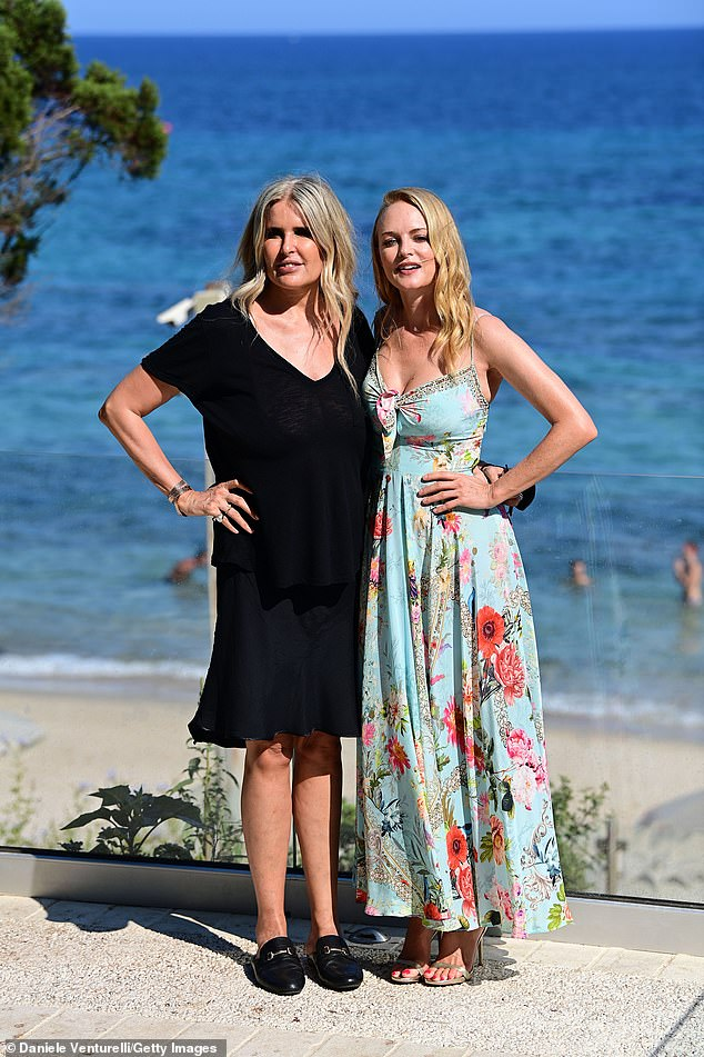 Fabulous: She also posed for pictures with producer Tiziana Rocca, who looked fabulous in a low-cut black dress