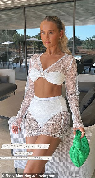 Beach Girl: On Friday, Molly-Mae looked amazing in a long-sleeved mesh crop top and matching miniskirt, which served as a beach blanket over her white bikini