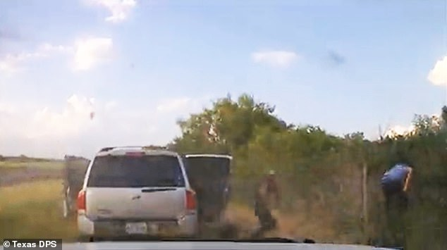 About a dozen illegal immigrants could be seen pouring out of the smuggler's car