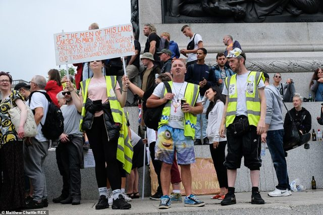 A number of demonstrators wore hi-vis jackets as they made their case in London's Trafalgar Square earlier this afternoon