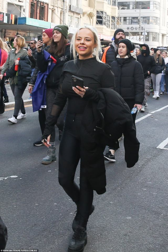 One woman dressed in all black without a mask marched through the anti-lockdown protest in Melbourne