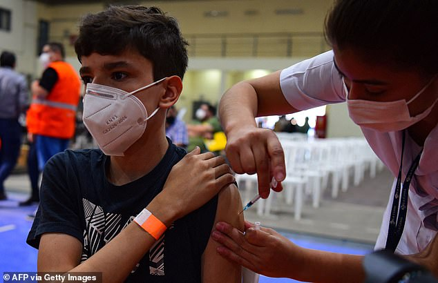 Some countries such as Paraguay are routinely vaccinating minors, but the the Joint Committee for Vaccination and Immunisation (JCVI) watchdog believes the potential risks of such a campaign may outweigh its benefits