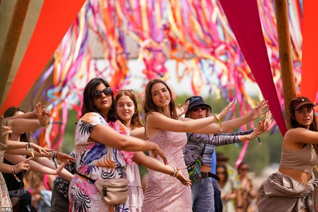 Festival goers take part in a movement session at the 'Mind, Body & Zen' area at Latitude festival in Henham Park, Suffolk