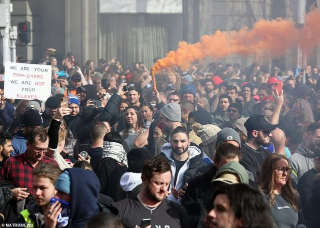 The streets of Melbourne were flooded with protesters, with some letting off orange flares as others clashed with police