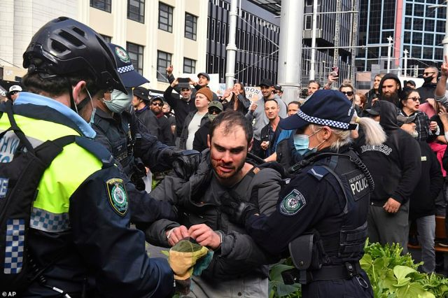 Protesters and police clash in the Sydney CBD with reports police had deployed pepper spray as the crowd grew increasingly unruly (pictured)
