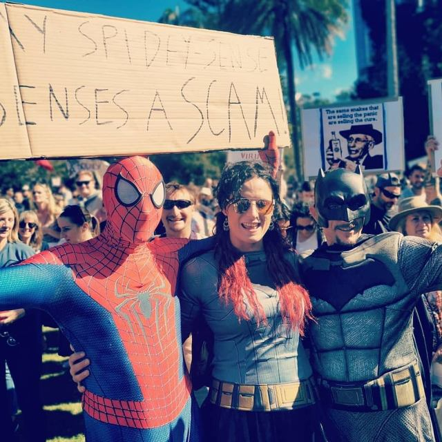 Pictured are protesters - one wearing a Spiderman costume - demonstrating against coronavirus lockdowns in Brisbane