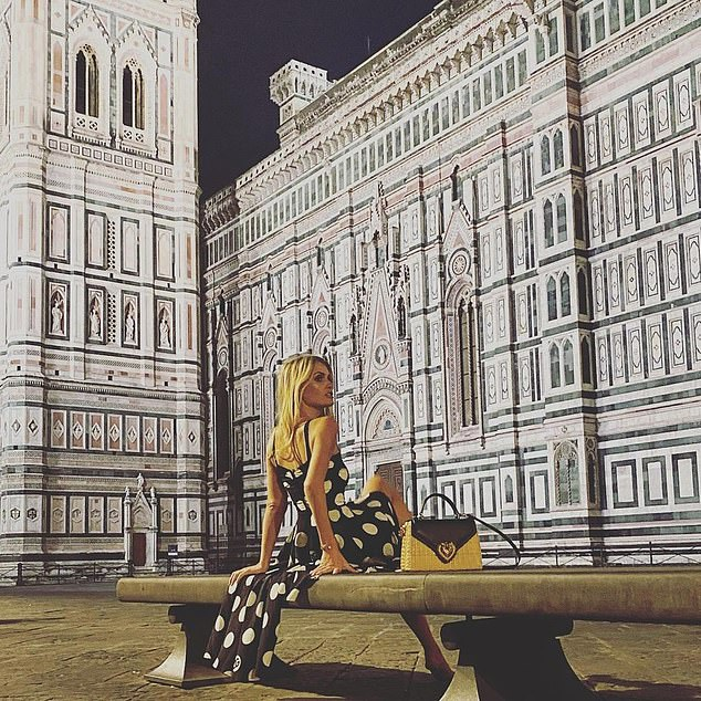 Lady Kitty Spencer dons a black and white polkadot dress as she poses in the iconic Piazza del Duomo