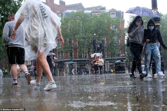 Rain bounces off the pavements in central London as people shelter under umbrellas as the capital was battered with heavy rain and thunderstorms