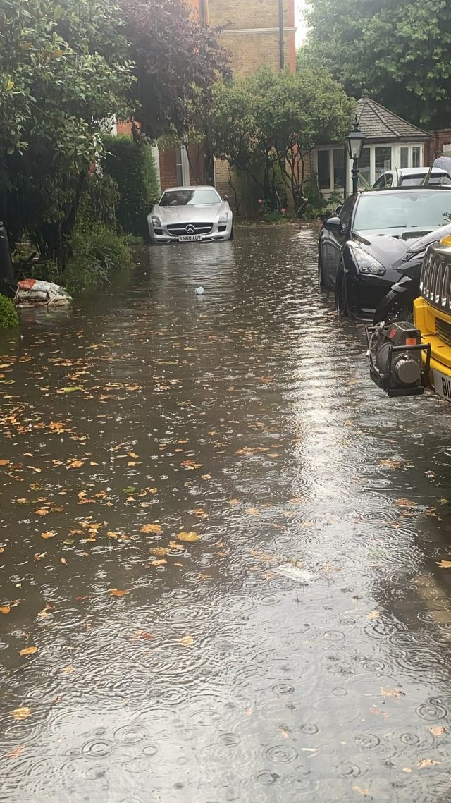 There was a warning for heavy downpours and thunderstorms for southern England and South Wales from 8pm Friday and over the next two days with up to 2in (50mm) of rain expected within just a few hours. Pictured: a flooded street in Battersea