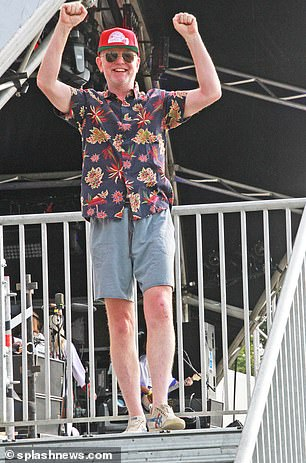 Celebrations!  Radio presenter Chris Evans looked ecstatic as he raised his arms in the air