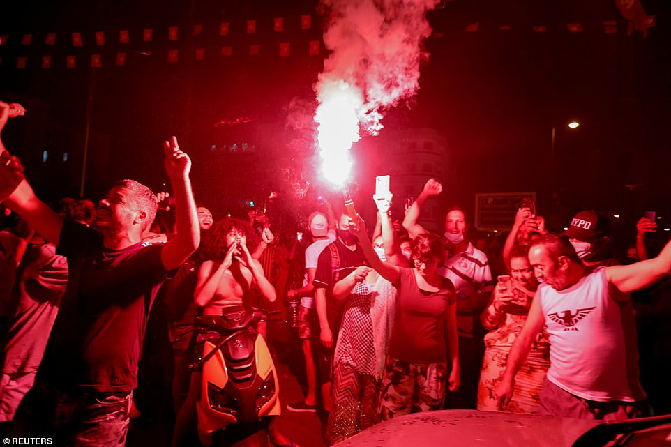 Flares and fireworks lit up the sky over Tunis on Sunday night as residents celebrated President Kais Saied's decision to sack the prime minister following a day of anti-government protests