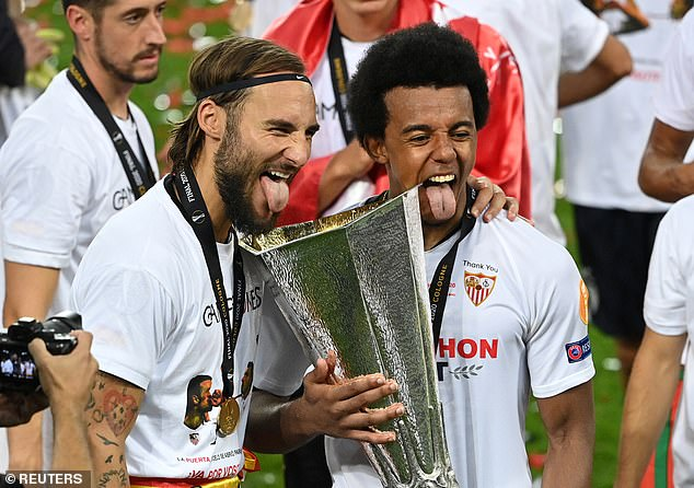 Kounde celebrates winning the 2020 Europa League after defeating Inter Milan in the final