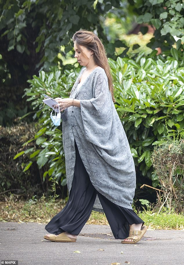 Low-key:The mother-to-be, 32, cut a relaxed figure as she stepped out in an oversized flowing grey cardigan and black wide leg trousers