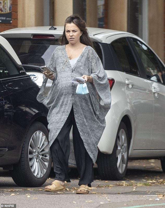 Keeping it casual:Louisa, who plays Ruby Allen on EastEnders, wore the bohemian cover-up which flowed over her blossoming baby bump