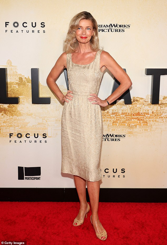 Perfection:The catwalker, 56, stunned in an ivory sleeveless midi dress patterned with a delicate sheen