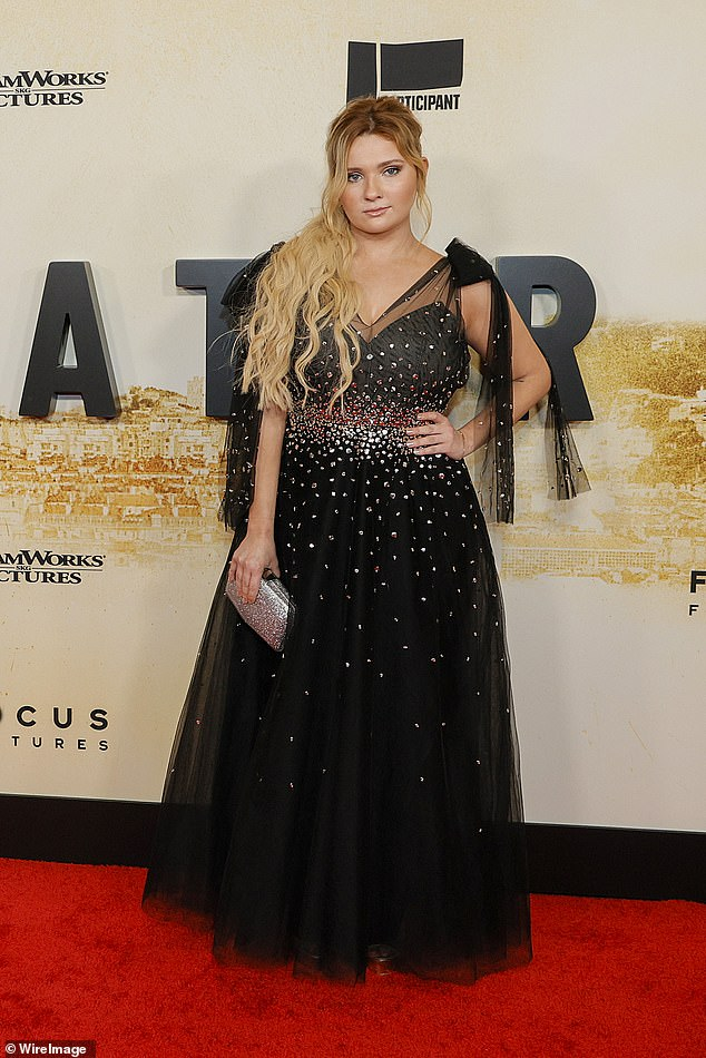 Beauty: Abigail Breslin looked stunning in a glamorous black tulle gown adorned with speckles of glitter to the premiere of Stillwater in NYC