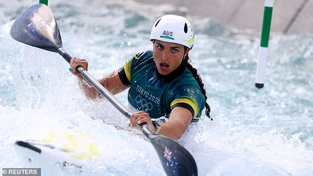 Fox is pictured storming into the women's K1 canoe slalom on Tuesday afternoon with the fastest time in her semi-final - 105.85 seconds