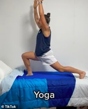 Another member of the team performed several yoga positions on top of the cardboard cot