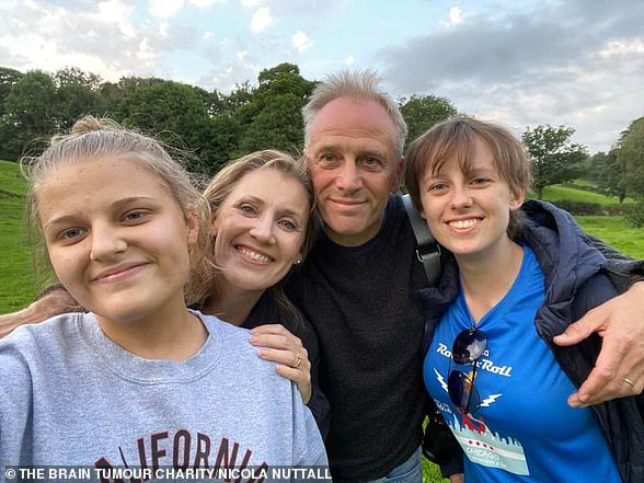 Laura Nuttall (right) with her parents Nicola and Mark (centre) and sister Gracie (left)