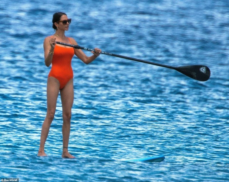 Chic: Her form-fitting swimwear featured a high-waist fit, delicate straps and a square neckline