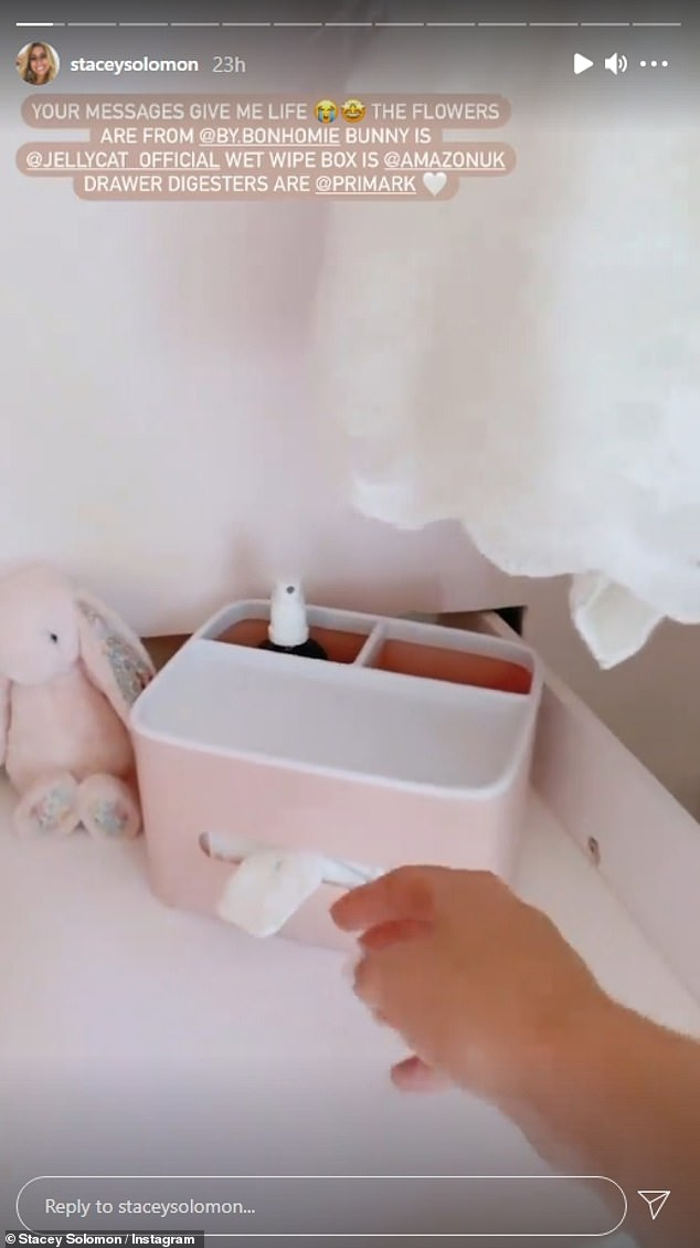 All pink everything: Her video showed the room, featuring a baby changing table with a vase full of neutral coloured dried flowers, tiny baby pink shoes, a Jellycat rabbit teddy and a pink wipe dispenser
