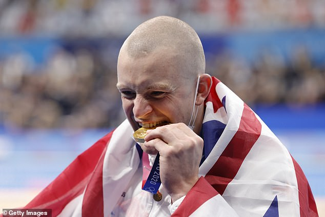 Team Great Britain's Adam Peaty, 26, bit into his gold medal after winning the 100-metre breaststroke on day three of the Tokyo Games